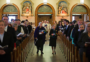 Sally Jackson and Betty Lukins walk into the church during the processional during a memorial for Tom Foley, the former U.S. Speaker of the House, at St. Aloysius Church in Spokane, Wash. Friday November 1, 2013.  (Photo courtesyof Gonzaga University)