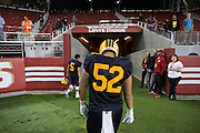 Milpitas unidentified player, 52, hangs his head as walks off the field in tears after losing to Valley Christian High School , 22-21, during Friday Night Lights at Levi's Stadium in Santa Clara, California, on September 18, 2015. (Stan Olszewski/SOSKIphoto)