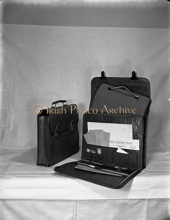 22/02/1953<br /> 02/22/1953<br /> 22 February 1953<br /> Advertising photographs of typewriter and briefcase for Precision Typewriter Service, Lower Rathmines Road, Dublin.