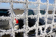 Frost forming on wire fence in winter. England