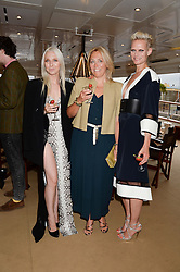 Johnnie Walker Blue Label hosts intimate game changer dinner for 10 Scottish influencers and key arts press aboard the John Walker & Sons Voyager moored at the Prince of Wales Docks, Leith, Edinburgh, Scotland on 14th August 2013.<br /> Picture shows:-Left to right, Lynne McCrossan, Maxine Sloss and Anna Freemantle.