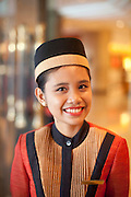 A door greeter at the five star hotel Shangra La.