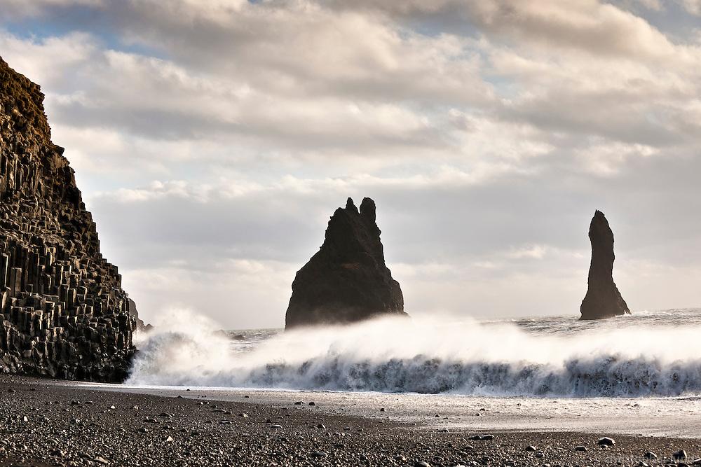 Reynisfjara black sand beach, south shore Iceland. Sea stacks in background.
