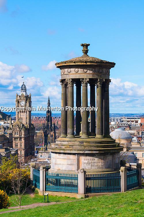 View of Dugald Stewart monument on Calton Hill and skyline in Edinburgh, Scotland