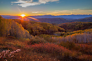 https://www.gettyimages.com/detail/photo/sunset-over-landscape-with-fall-foliage-high-res-stock-photography/694152539?adppopup=true