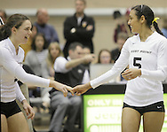 West Point, NY - Two Army volleyball players talk before a match against Lehigh in the Patriot League women's volleyball tournament at the United States Military Academy on Nov. 21, 2009.