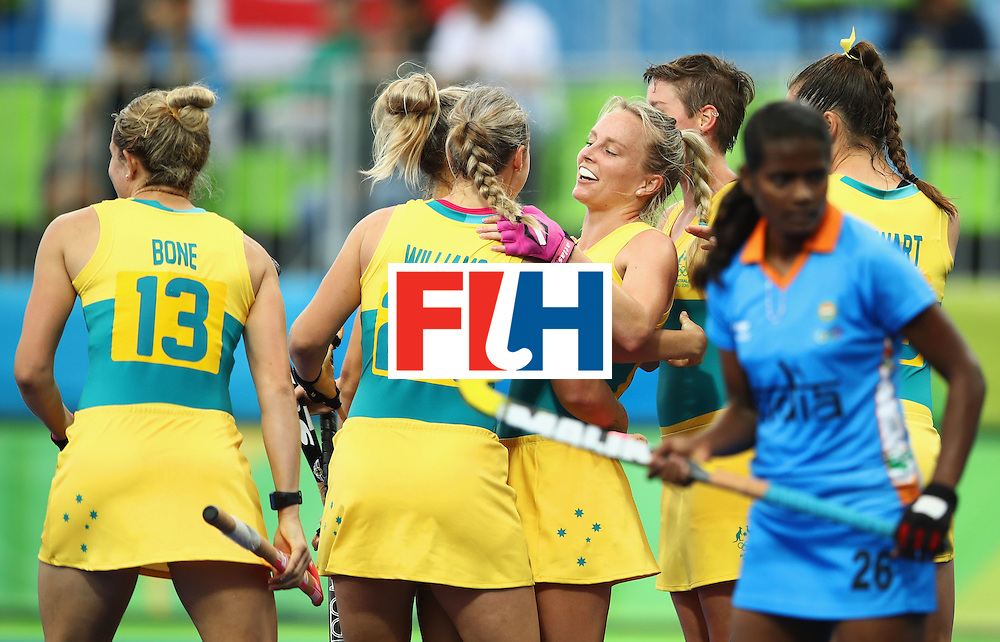 RIO DE JANEIRO, BRAZIL - AUGUST 10:  Jane-Anne Claxton of Australia (C) celebrates scoring a goal with team mates during the Women's Pool B Match between India and Australia on Day 5 of the Rio 2016 Olympic Games at the Olympic Hockey Centre on August 10, 2016 in Rio de Janeiro, Brazil.  (Photo by Mark Kolbe/Getty Images)