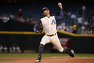 PHOENIX, AZ - APRIL 06:  Robbie Ray #38 of the Arizona Diamondbacks delivers a pitch in the first inning against the San Francisco Giants at Chase Field on April 6, 2017 in Phoenix, Arizona.  (Photo by Jennifer Stewart/Getty Images)