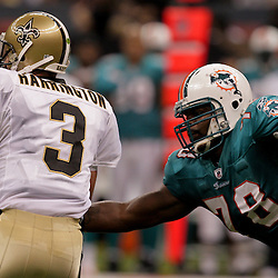 2009 September 03: New Orleans Saints quarterback Joey Harrington (3) is pressured by Miami Dolphins defensive tackle Tony McDaniel (78) during a preseason game between the Miami Dolphins and the New Orleans Saints at the Louisiana Superdome in New Orleans, Louisiana.