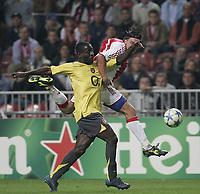Ashley cole and Zdenek Grygera.<br />Photo: Barry Bland.<br />Ajax v Arsenal. UEFA Champions League.<br />27/09/2005.