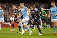 Melbourne City defender Ritchie de Laet (2) controls the ball away from Melbourne Victory forward Kenny Athiu (7) at the Hyundai A-League Round 1 soccer match between Melbourne Victory and Melbourne City FC at Marvel Stadium in Melbourne.