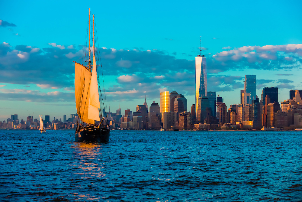Sailing ship with Lower Manhattan behind, New York, New York USA.