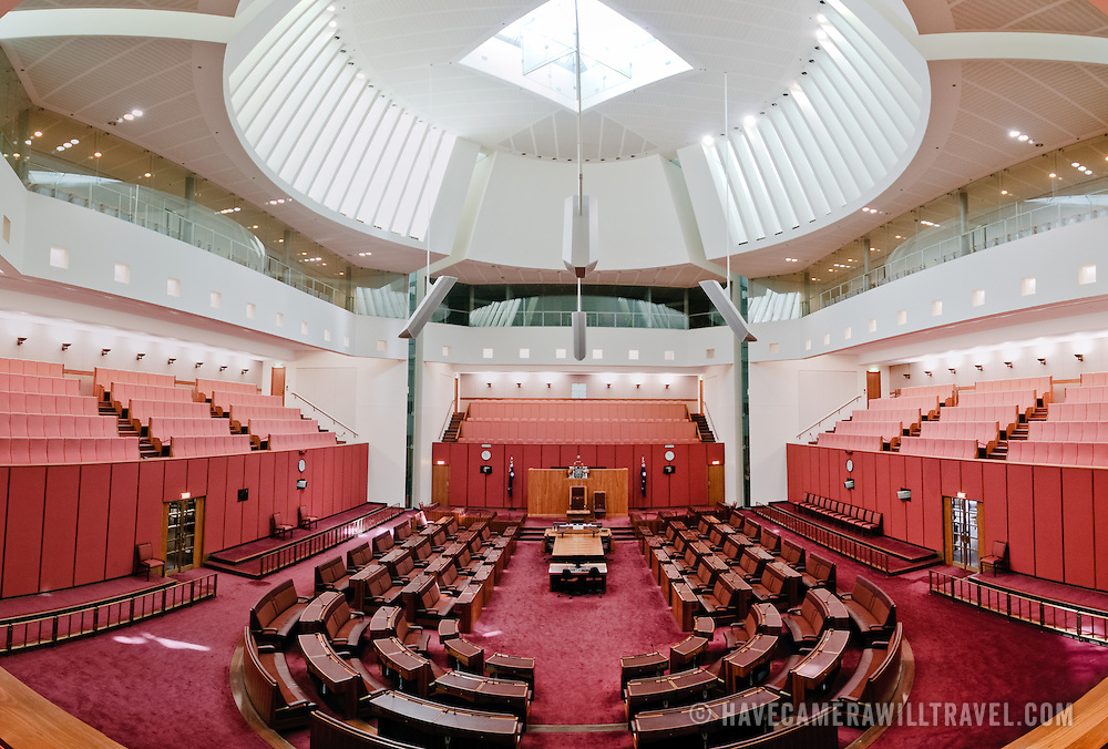 """The Senate building follows the colour scheme of the House of Lords, decorated in red, this time muted to tints of ochre, suggesting the earth and the colours of the outback. Parliament House is the meeting place of the Parliament of Australia. It is located in Canberra, the capital of Australia. It was opened on 9 May 1988 by Queen Elizabeth II, Queen of Australia.[1] Its construction cost was over $1.1 billion. At the time of its construction it was the most expensive building in the Southern Hemisphere. Prior to 1988, the Parliament of Australia met in the Provisional Parliament House, which is now known as """"Old Parliament House""""."""