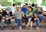 FALLSINGTON, PA -  SEPTEMBER 14:  From left, Bobby Allen, Kristina Allen, Blaire Belle, and Jonathan Belle, of Middletown, Pennsylvania share a laugh at the Irish Festival September 14, 2013 in Fallsington, Pennsylvania. (Photo by William Thomas Cain/Cain Images)