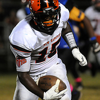 New Hanover High School's Karon Reid rushes against Laney High School Friday October 17, 2014. (Jason A. Frizzelle)