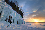 The rising sun casts a glow on the ice curtains of Grand Island, Michigan's Upper Peninsula