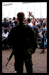 1st Sept, 2005. Mass evacuation of New Orleans begins. Thousands of desperate people mass outside the Superdome hoping for a seat on a bus to take them out of New Orleans. A desperate parent holds his child above his head in an attempt to get the attention of the Louisiana National troopers.