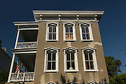 A classic three story stucco brick Charleston single home at 17 Meeting Street in historic Charleston, SC.