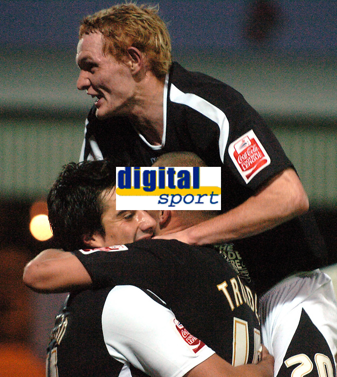 Photo: Paul Greenwood.<br />Port Vale v Swansea City. Coca Cola League 1. 18/11/2006.Shaun Macdonald, centre, celebrates victory with Rory Fallon and Lee Trundle.