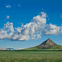 fair weather clouds over haystack butte in the spring, rocky mountain front, montana, russel country, montana, usa, russell