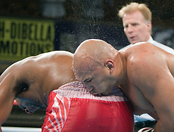 February 16, 2006 - New York, NY - Heavyweight Fres Oquendo looks as if he's planting a kiss on the backside of his opponent Daniel Bispo during their 10 round heavyweight fight.