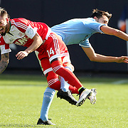 Diego Fagundez, (left),  New England, is fouled by Andoni Iraola, NYCFC, during the New York City FC Vs New England Revolution, MSL regular season football match at Yankee Stadium, The Bronx, New York,  USA. 26th March 2016. Photo Tim Clayton