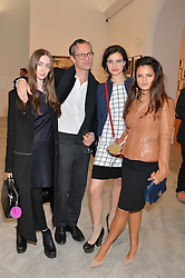 Left to right, CAITLIN CURRAN, MILES ALDRIDGE, EVANGELINE LING and BIP LING at a private view of photographs by David Bailey entitled 'Bailey's Stardust' at the National Portrait Gallery, St.Martin's Place, London on 3rd February 2014.