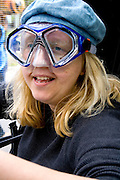 Portrait mobile fish tricycle driver representing creatures of the water. MayDay Parade and Festival. Minneapolis Minnesota USA