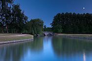 Moonlight illuminates the river Cam in Cambridge, England.