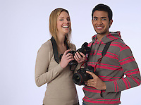 Portrait of young photographers with cameras studio shot