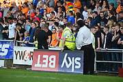 Stewards remove a vandalised Sky Sports ad board during the EFL Sky Bet League 1 match between Northampton Town and Oldham Athletic at Sixfields Stadium, Northampton, England on 5 May 2018. Picture by Dennis Goodwin.