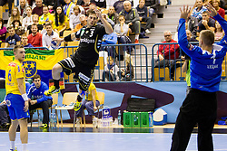 Uwe Gensheimer #3 of Rhein-Neckar Lowen during handball match between RK Celje Pivovarna Lasko (SLO) vs Rhein-Neckar Lowen (GER) in 3rd Round of Group A of EHF Champions League 2013/14 on October 12, 2013 in Arena Zlatorog, Celje, Slovenia. (Photo By Urban Urbanc / Sportida)