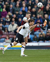 Derby County's Chris Martin battles with Burnley's Jason Shackell - Photo mandatory by-line: Matt Bunn/JMP - Tel: Mobile: 07966 386802 22/02/2014 - SPORT - FOOTBALL - Turf Moor Stadium- Burnley - Burnley  v Derby County- Sky Bet Championship
