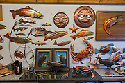Photos of copper artist Clark Mundy and his work in his Port Angeles WA studio. He is renowned for his sculptures of salmon, native American masks, and sea life, all made from sheet copper. He creates them using a simple array of tools: copper snips, a torch for heating and annealing the metal, copper welding rod, and small tools for hammering the metal into shapes of his design.