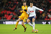 Erik Lamela of Tottenham Hotspur (11) battles for possession with Brighton and Hove Albion midfielder Davy Propper (24) during the Premier League match between Tottenham Hotspur and Brighton and Hove Albion at Wembley Stadium, London, England on 13 December 2017. Photo by Matthew Redman.