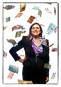 SHOT 6/13/11 4:37:46 PM - Deborah Quintana, President and CEO of World Wide Money Exchange, owns and operates the money exchanges at Denver International Airport. She was photographed with a variety of currency that they are able to exchange at DIA. (Photo by Marc Piscotty / © 2011)
