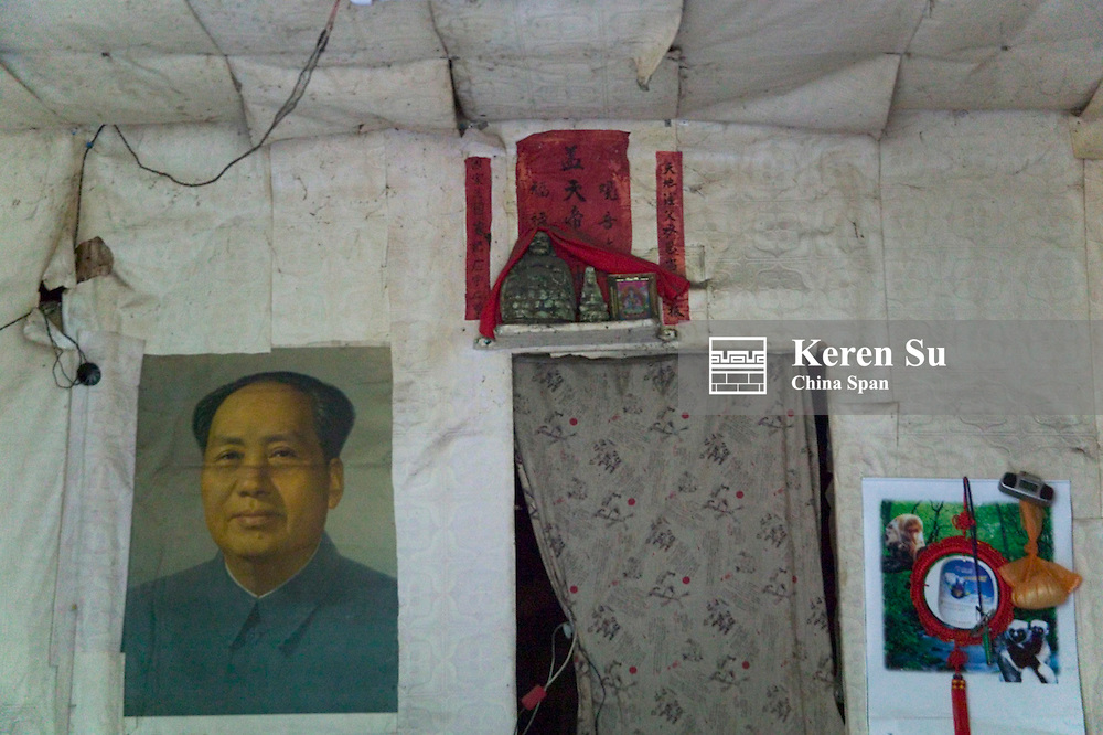 Inside of an old house, Chairman Mao's poster and red lucky poster on the wall, Ningchang, Three Gorges, Yangtze River, China