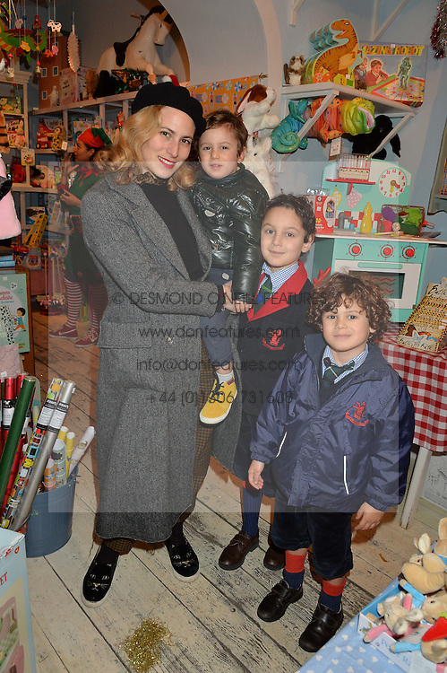 LONDON, ENGLAND 1 DECEMBER 2016:Left to right, Charlotte Olympia, Rio Crewe, Ray Crewe, Ike Crewe at the 10th birthday party for the toy shop HoneyJam, 2 Blenheim Crescent, Notting Hill, London, England. 1 December 2016.