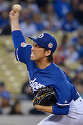 Dodger pitcher Kenta Maeda in the 1st inning. The Los Angele Dodgers played the Los Angeles Angels of Anaheim in the 2nd game of the pre-season freeway series at Dodger Stadium in Los Angeles, CA.  April 1, 2016.  (Photo by John McCoy/Los Angeles News Group)