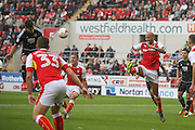 Brentford  defender John Egan (14)  header is blocked by Rotherham United defender Kelvin Wilson (16)  during the EFL Sky Bet Championship match between Rotherham United and Brentford at the New York Stadium, Rotherham, England on 20 August 2016. Photo by Simon Davies.