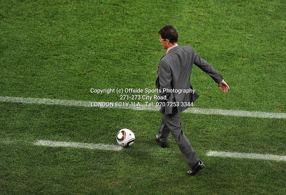 18/06/2010 World Cup. England v Algeria.<br /> Fabio Capello kicks the ball.<br /> Photo: Mark Leech.