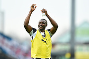 Notts County forward Shola Ameobi (9) applauds the Notts County supporters during the EFL Sky Bet League 2 match between Notts County and Coventry City at Meadow Lane, Nottingham, England on 7 April 2018. Picture by Jon Hobley.
