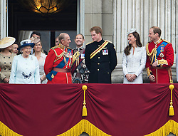 © London News Pictures.. 14/06/2014. Front L to R HRH Queen Elizabeth II, Price Philip Duke of Edinburgh, Prince Harry, Catherine Duchess of Cambridge and Prince William join other member of the royal family on the balcony of Buckingham Palace during the annual Trooping the Colour Ceremony in central London. The event marks the queens official birthday. . Photo credit:Ben Cawthra/LNP