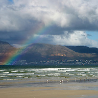 Africa, South Africa, Cape Town. Rainbow at Muizenberg Beach near Cape Town.