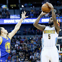 13 February 2017: Denver Nuggets guard Will Barton (5) takes a jump shot over Golden State Warriors guard Stephen Curry (30) during the Denver Nuggets 132-110 victory over the Golden State Warriors, at the Pepsi Center, Denver, Colorado, USA.