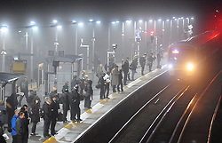 © Licensed to London News Pictures. 16/10/2013<br /> A cold,wet and slighty misty morning (16.10.2013) for London commuters this morning at Pettswood Station in Greater London.<br /> Photo credit :Grant Falvey/LNP