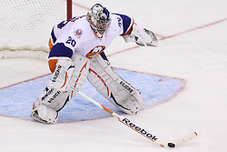 Mar 8; Newark, NJ, USA; New York Islanders goalie Evgeni Nabokov (20) pokes the puck away during the third period at the Prudential Center. The Devils defeated the Islanders 5-1.