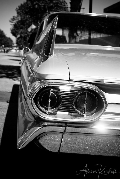 Street view of the fins and chrome lines of a classic car