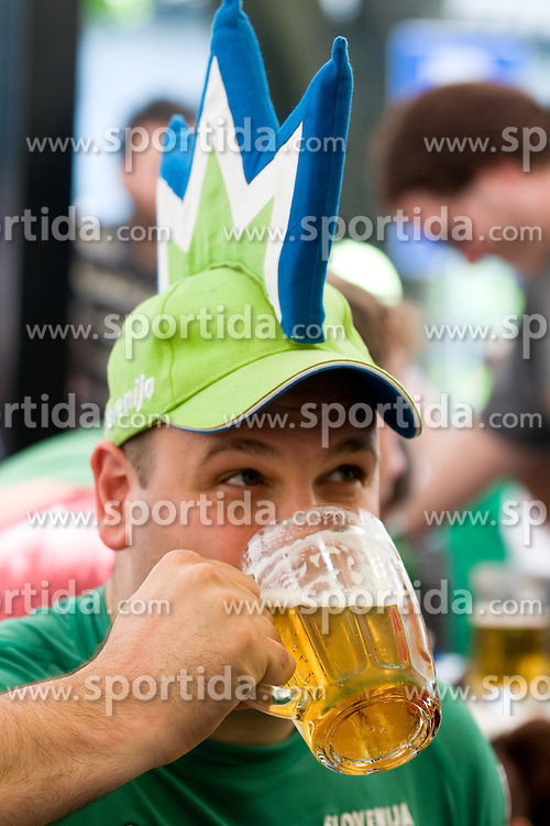 Slovenian supporter with glass of beer in Ljubljana during the 2010 FIFA World Cup South Africa Group C Third Round match between Slovenia and England on June 23, 2010, in Ljubljana, Slovenia. (Photo by Matic Klansek Velej / Sportida) / SPORTIDA PHOTO AGENCY