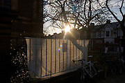 A sunlit banner on the railings of Carnegie Library in Herne Hill, south London while occupiers remain inside the premises on day 5 of its occupation. The angry local community in the south London borough have occupied their important resource for learning and social hub for the weekend. After a long campaign by locals, Lambeth have gone ahead and closed the library's doors for the last time because they say, cuts to their budget mean millions must be saved.